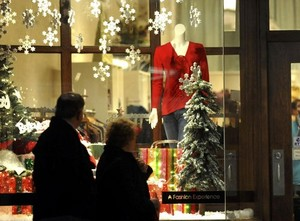 By David Crigger/Bristol Herald Courier — Patrons walk by a decorated window during the annual Believe in Bristol Downtown Open House Monday evening.